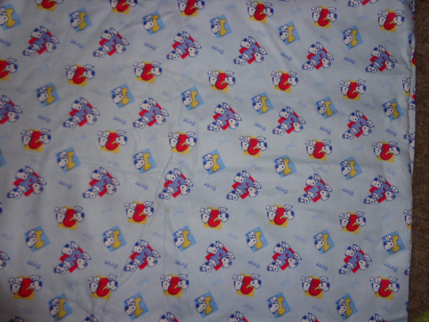 Snoopy with abc 39 s flannel fabric by the half yard by for Children s flannel fabric by the yard