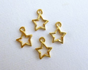 Gold Open Star Charms -- 4 pieces -- Vintage Style Tierracast Pewter Celestial Pendants