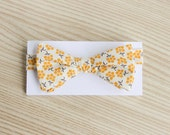 Cream Bow Tie with Yellow Flower Bunches