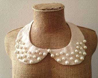 Col Claudine in old linen and beads