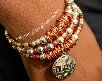 Orange memory wire bracelet with charm