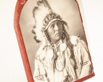 Native American Indian Photographic Portrait of Spotted Jack Rabbit, a Crow, taken by Frank Rinehart in 1898 on 3 X 5 Inch wood  w/standard.