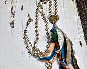The seamstress.  Faux pearl rosary chain and sewing notions necklace.  OOAK, handmade by ladeDAH!