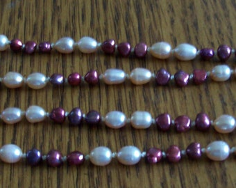 Pink and burgundy knotted freshwater pearl necklace about 24 inches
