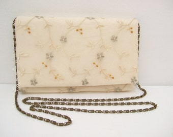 Cream silk and embroidered tulle evening bag with bronze chain shoulder strap.