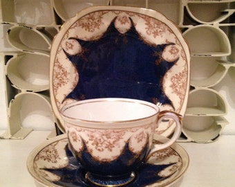 1930s Vintage tea cup, saucer and tea plate made by Crown Staffordshire. Teacup trio with gold and blue pattern, 4 available. 1930s. TT075.