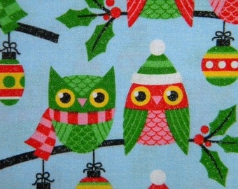 Santa's Friends Owl fabric on blue 1 yard Cotton, specks of silver glitter