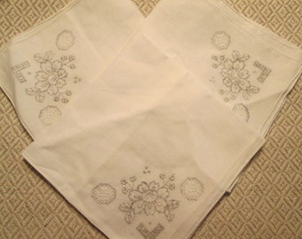 Lot of 3 beautiful embroidered handkerchiefs.