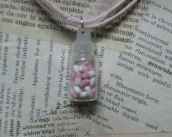 Pink bottle of pills necklace