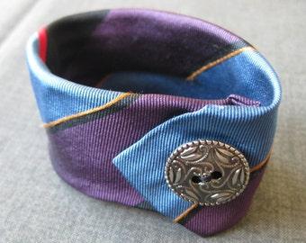 Necktie bracelet w/ silver metal button and snap closure