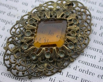 Magnificent french antique honey amber color glass faceted  gold ornate frame floral filigree brooch .