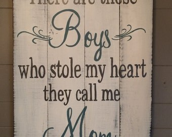 There are these boys hand painted sign