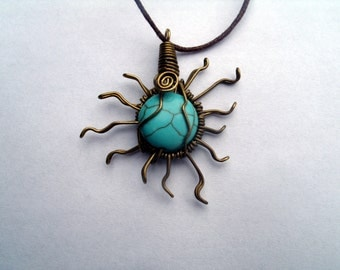 Pendant sun wirewrapped  turquoise coloured howlite