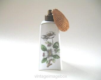 Vintage perfume bottle, ceramic obelisk shape with white flowers, pottery ornament