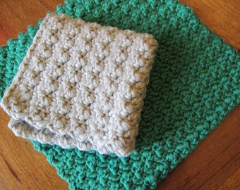 two organic cotton dishcloths. light grey and emerald green.