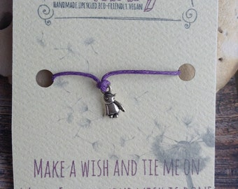 Wish bracelet with penguin charm on purple cord. Friendship bracelet, wedding, bridesmaid, hen party, favours. Buy 4 get 1 free.