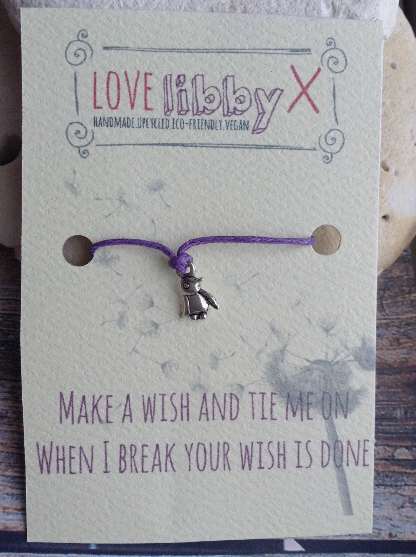 Wish bracelet with penguin charm on purple cord. Friendship bracelet, wedding, bridesmaid, hen party, favours. Buy 4 get 1 free.