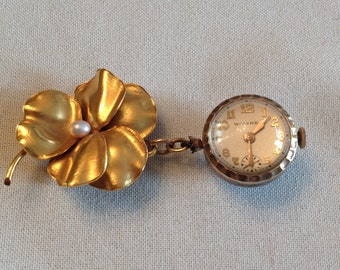 Antique vintage ladies Waltham pools of light crystal orb watch exposed gears on pansy pin w/pearl