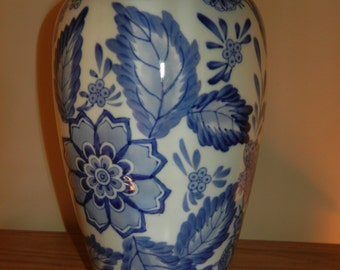 Fine Porcelain  Vase in White with a Blue Floral Design