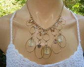 Flowing dangles of clear beads and gold tone large looped necklace.  Great for a gift or keep for yourself.  Wear with jeans and a tee.