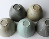 a set of 5 medium bowl in different colours and designs