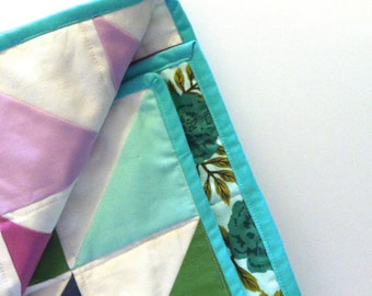 Purple, green, and blue triangle quilt