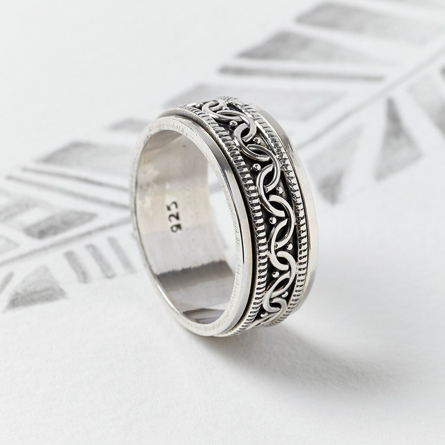 celtic sterling silver spinning ringspin by charlotteswebetsy