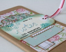 Small mixed media notebook with hand embroidered tag and pretty paper layers
