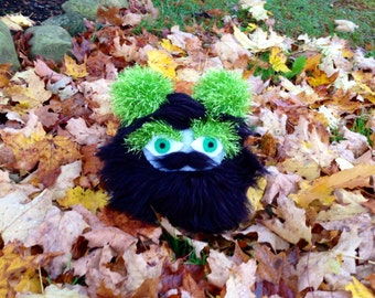 Bark the Troublewump - Juvenile Brumblewump - He is Not a Monster! Black, furry stuffed animal with a mustache. Children's book character.