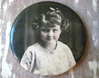 1920's photograph portrait pocket mirror rosy cheeked little girl.