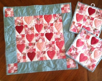 Set of Hand made  Valentines Day Placemat and potholders.  Hand appliqued hearts and nine patch squares.  Machine quilted