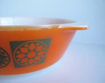 JAJ Pyrex bright orange round casserole dish. Unusual pattern and colour! Seventies? Geometric pattern.