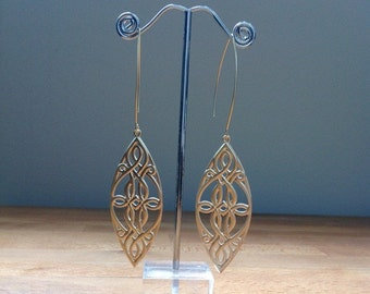 Long matte gold celtic earrings