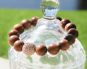 Designer Goldstone Stretch Bracelet With Bling Ball
