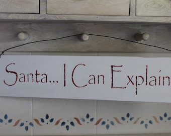 Santa, I can explain! Stenciled wood sign