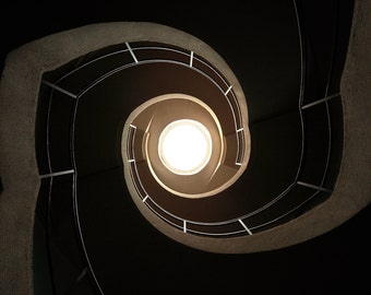 Abstract photography of abandoned spiral stairs in a factory in France