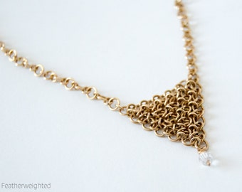 Gold and crystal chevron necklace | handmade jewelry for charity.
