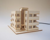 BAUWOW - A small, illuminated model. Based on a real Bauhaus building, located in Tel-Aviv, Israel - The white city
