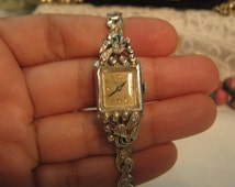 Vintage 14K white Gold Diamond Bulova manual wind watch. 16.6 grams.