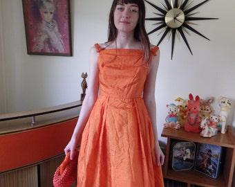 1950s orange sundress - rockabilly with sweet bow shoulder detail - would look great with a flouncy petticoat underneath