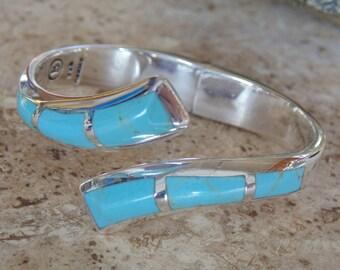 Bernice Goodspeed ~ Sterling Silver and Blue Bypass Bracelet