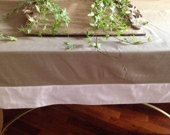bicoloured white tablecloth and Dove