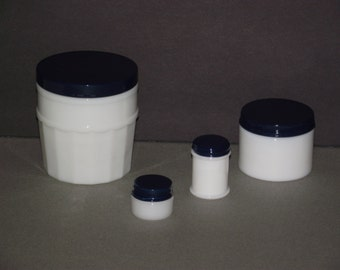 A foursome of vintage 1940s milk glass dresser/make up jars with freshly primed & painted Navy blue metal lids.