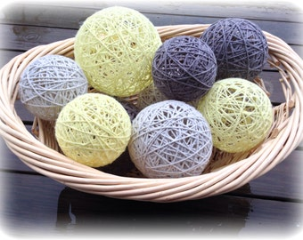 Yellow and gray yarn balls