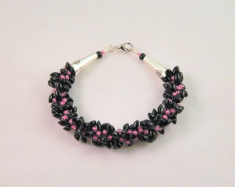 Edgy Pink and Black Kumihimo Bracelet with Glass Sead Beads and Magatama Beads