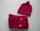 Child's cabled hat with pom-pom and cowl scarf in Raspberry Red