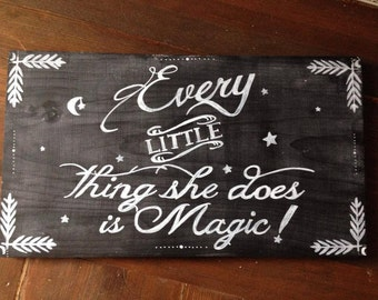 Every little thing she does is magic. Hand painted, wooden sign.