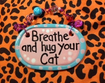 Breathe and hug your cat pink ceramic sign
