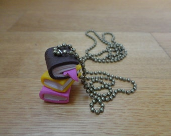 A pile-of-books necklace for the bookworms like me.
