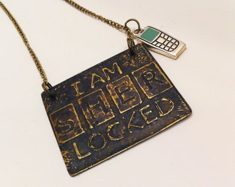 """Sherlock Holmes """"I am SHER Locked"""" Cellphone Password Pendant with Cellphone Charm"""